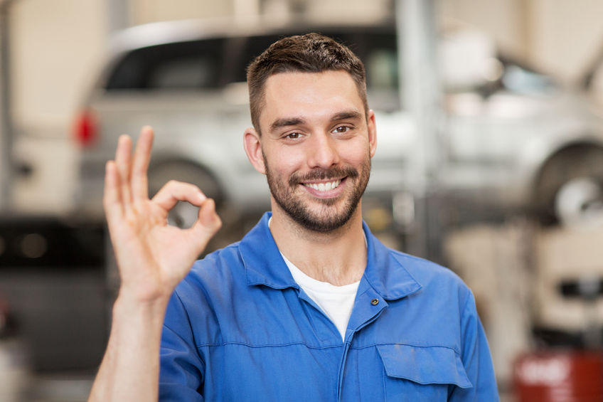 ar service, repair, maintenance and people concept - happy smiling auto mechanic man or smith showing ok hand sign at workshop
