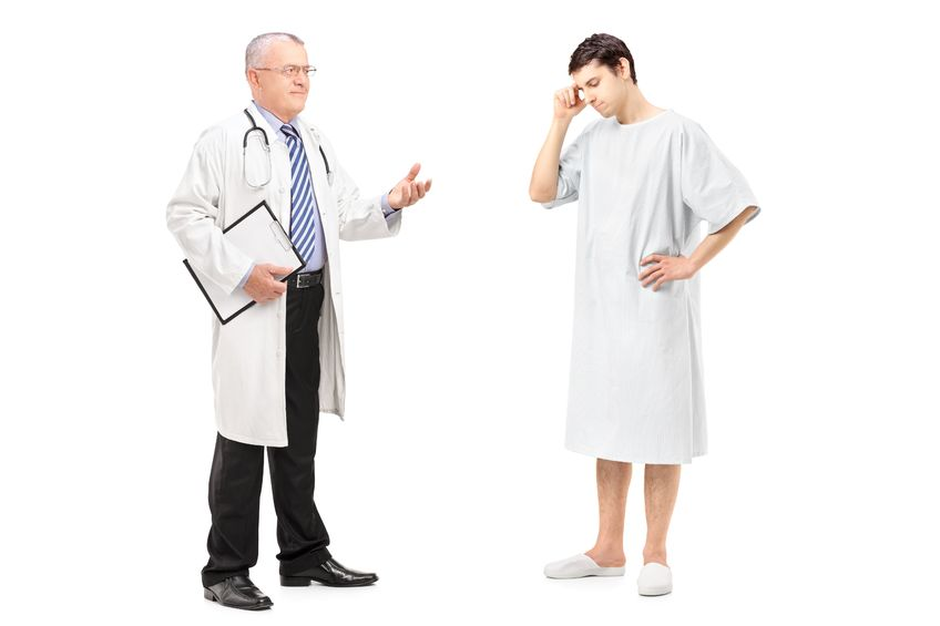 Doctor talking to patient. Male patient looking like they are thinking about something