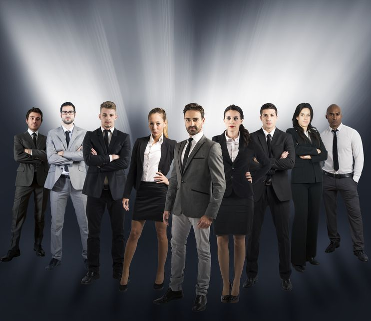 group of business professionals looking at camera